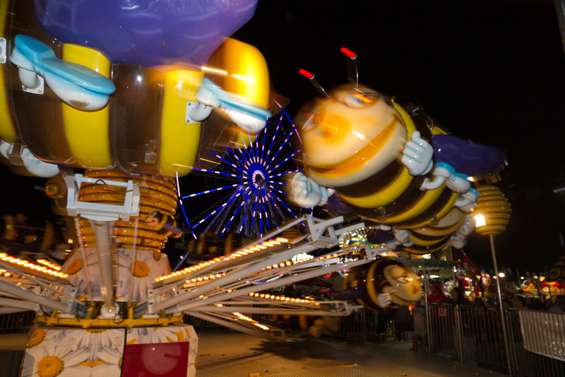 It was a long day at the rodeo and I was about to leave. I never actually saw the rodeo, but opted for the vendor area, livestock show and carnival. I figured there was enough to shoot there and I was right. I was leaving and turned for one last look and saw the ferris wheel through this