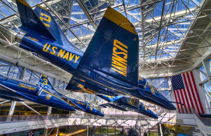 These A-4 Skyhawks are a previous generation of the Blue Angels and now hang in the Blue Angels Atrium, a ceremonial section of the National Naval Aviation Museum. Photo by Tim Stanley Photography.