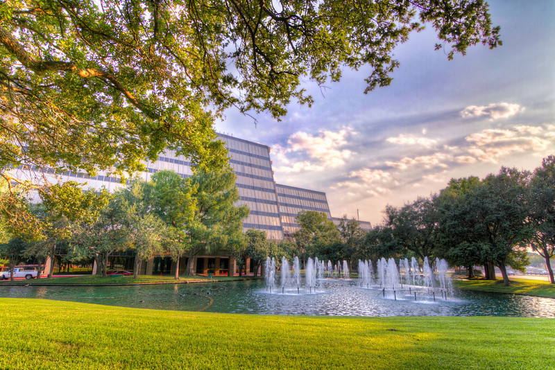 This landscape and fountains are very pretty, but the trees that frame them so well, help hide them from the passing public. Photo by Tim Stanley Photography.