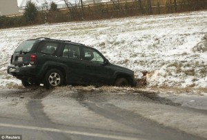 car in ditch in winter accident