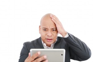 Stressed man with iPad