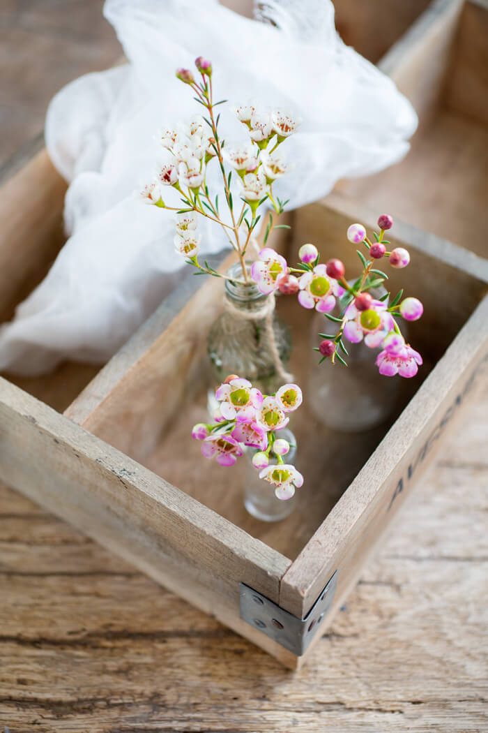 wax flowers in little vases