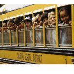 325543school-children-looking-out-school-bus-windows-posters