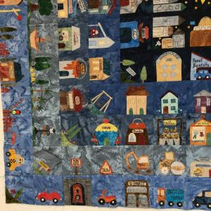 The bottom-left of the large That Town And Country quilt.