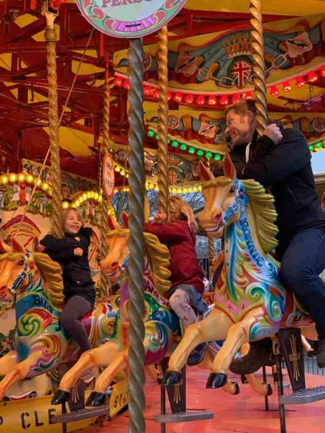 Rinding the Golden Carousel on South Bank in London