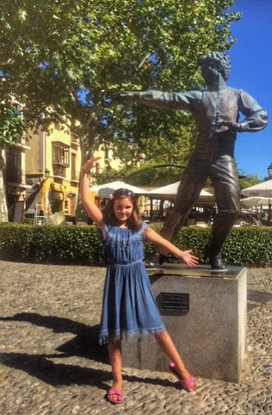 Girl mimics flamenco statue