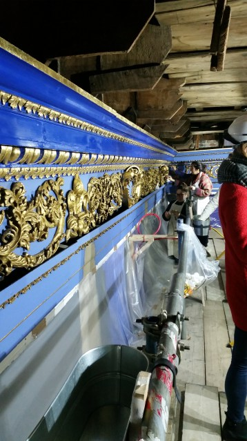 Up in the roof of the King's Presence Chamber the conservators are at work