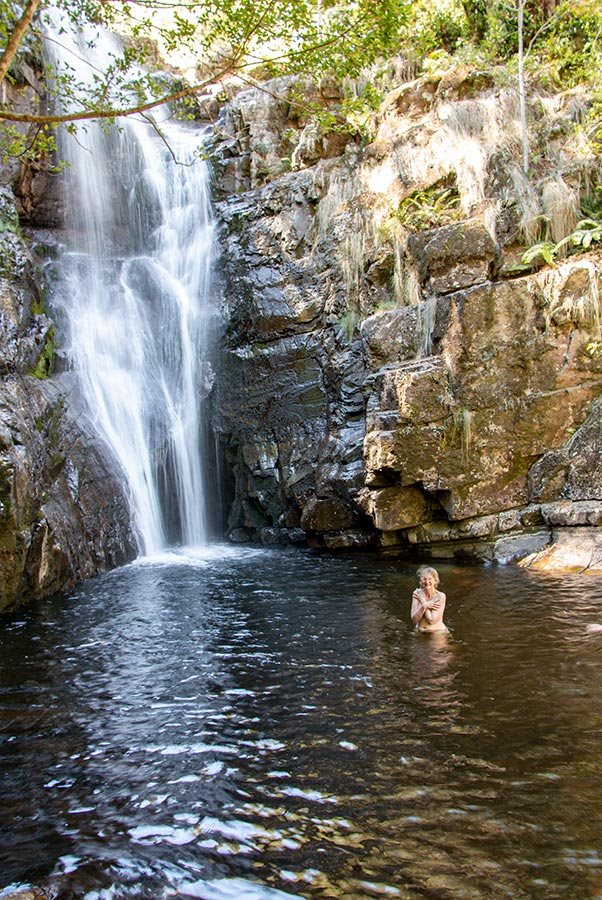 Top skinny dipping location sin north east Tasmania - Woman with no clothes in a deep rock pool below a water fall