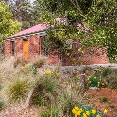 The brick Ah Moy two-bedroom cottage is better suited to two couples or a small family of three.
