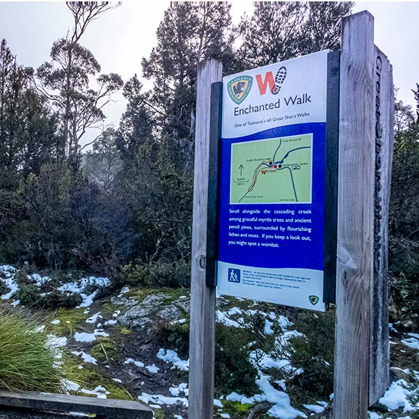 The Tasmanian Parks and Wildlife Service sign describing the Enchanted Walk.