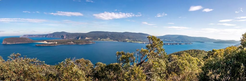 Panoramic view across Crescent bay to Cape Raoul.