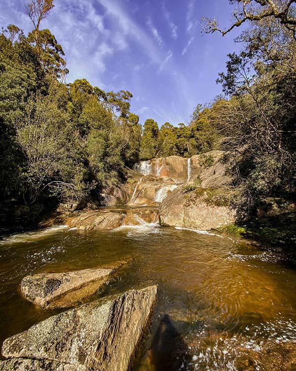 Harridge Falls with a deep blue sky backdrop.