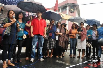 Relatives of the massacre victims speak in front of the Mendiola Peace Arch Saturday to call for justice. Photo by Demerie Dangla, UP Aperture