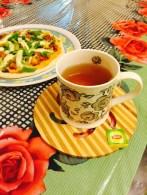 Lemon green tea and homemade pizza