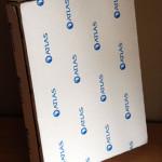 La boîte en carton contenant l'Album.