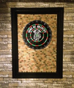 I gave Soldier Boy the dartboard for Christmas and made the backboard out of donated corks and an old frame we found at the cabin.