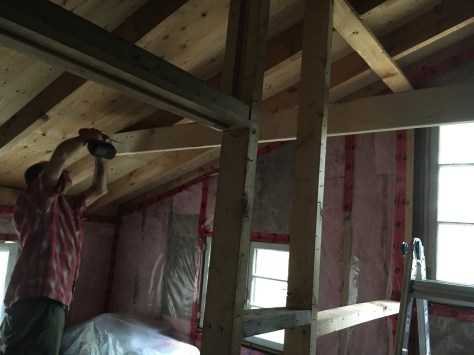 We attached the joist to the sloped rafter on one side.