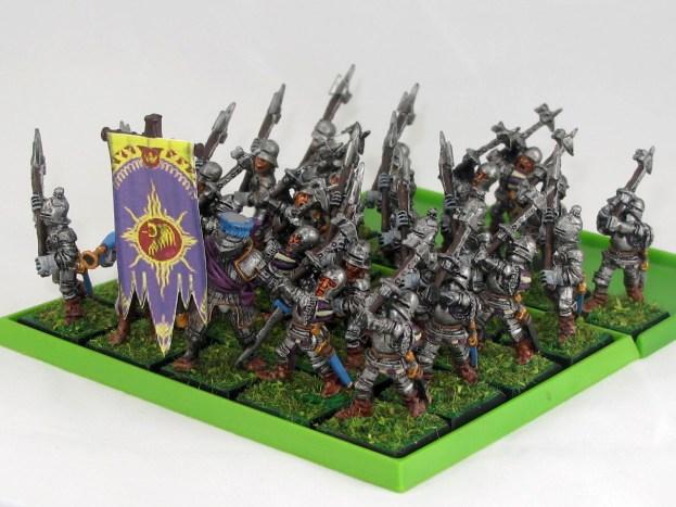 The standard bearer is an old Reiksguard knight