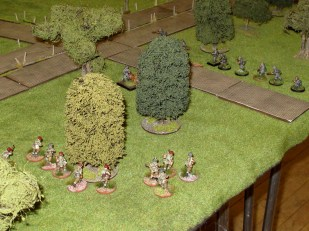 Both sides deploy in the woods south of the main road, with a smaller road separating them.