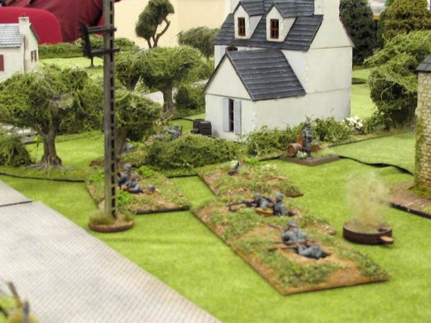 The defending Germans show their hand by opening fire on the advancing paras