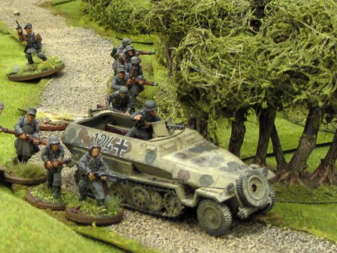 German infantry with supporting halftracks attack the British lines