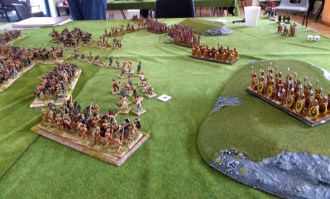 The barbarian and Roman units jockey for position in an early game.