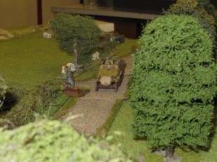 German half track approaches carefully down the road