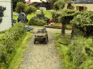 Life might be about to get interesting for this driver as that Cromwell pokes through the hedge behind him