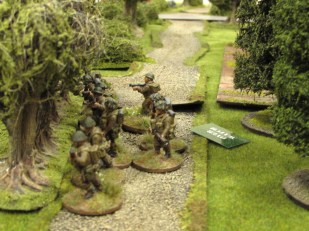 British troops infiltrate through the orchard and cross the road