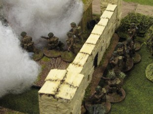 Brits breach the farm walls under cover of smoke
