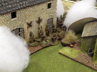The storming party prepares to assault the barn, with plenty of smoke protecting them.