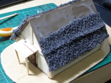 Adding strips of towel to make the thatch