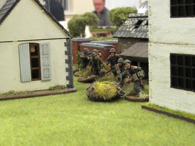 A German section moves up to the back door of the farm house