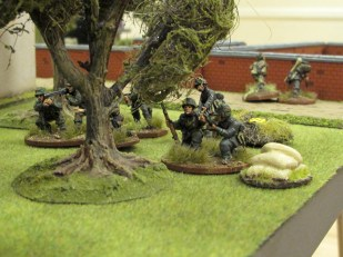 Fresh German troops reinforce the left flank. Remnants of the first squad flee in the distance.