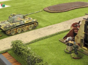 The German CO enjoys watching the Panther hammer shots down the road at the British tanks