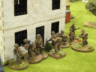 Counter-attacking against the German advance, British troops move up to the back of the farmhouse