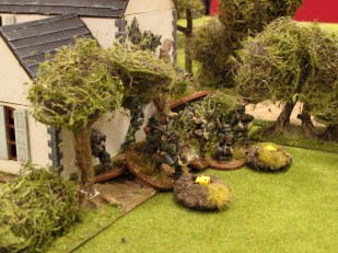Spotting the Churchill, the Germans rush to get behind cover