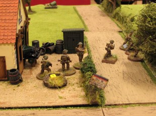 Under HE fire from the AT gun, the boys work their way forward