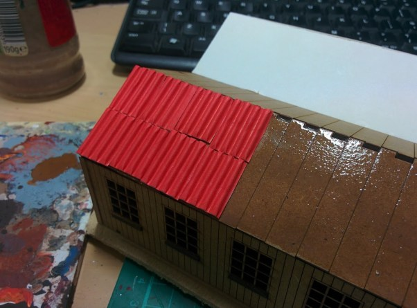 Adding the corrugated card pieces to the roof.