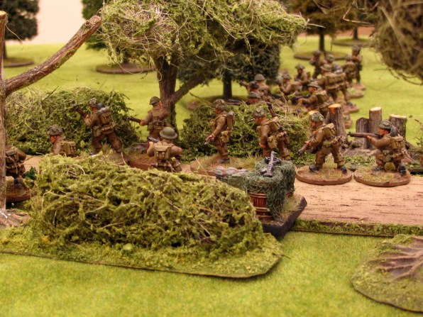 More British troops infiltrate up the road past their base of fire