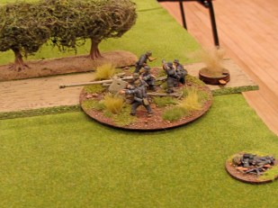Taking accurate return fire the Pak 40 crew keep their heads down and get on with the job