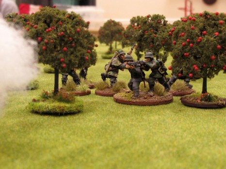 The Germans move their guns up to the edge of the orchard