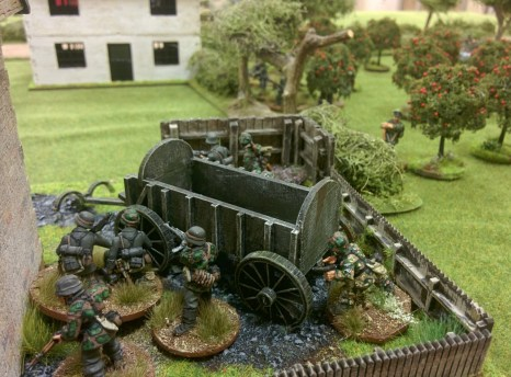 Panzergrenadiers move up carefully with no sign of resistance