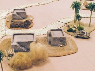 Dust, palm trees and tanks