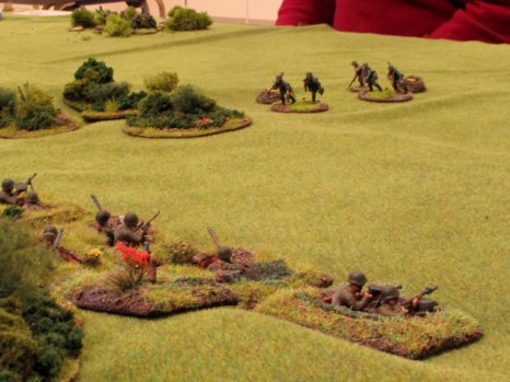 The well dug-in Soviet troops up the slope pour a murderous fire at the unlucky Germans in the open.