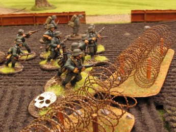 German pioneers throw themselves bravely onto a line of Soviet wire and bunkers