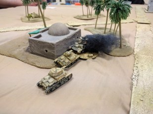 After the M11/39 rams the damaged A10, the Italian M13/40 finishes it off with gunfire.