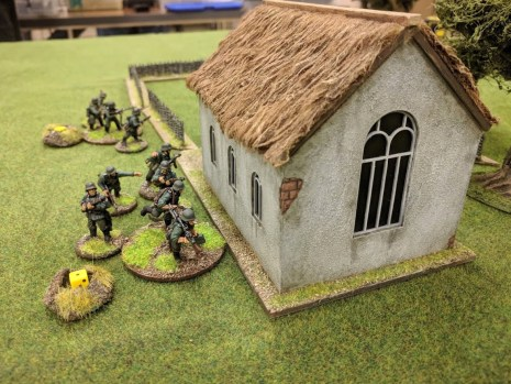 The Germans sprint up behind the church then catch their breath