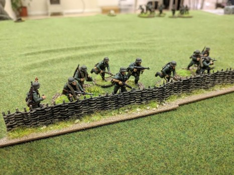 The third German squad moves up adjacent to the church