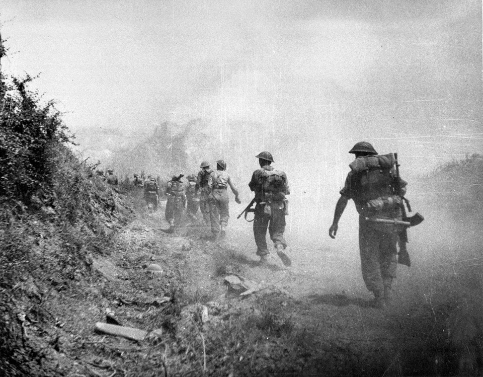 British soldiers advance through smoke